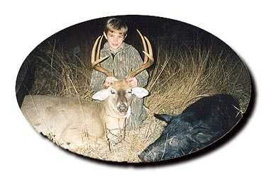 Junior hunter with deer and javelina